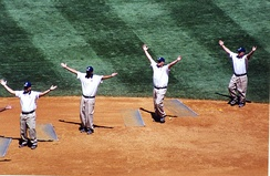 Members of the grounds crew of Yankee Stadium pause to do the YMCA dance.