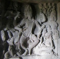 Parvati and Dancing Shiva (right) in an Ellora cave.