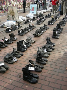 Combat boots arrayed in memory of the U.S. military war dead as part of an anti-war demonstration (Seattle, 2007).