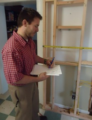 To plan a renovation, this architect takes measurements, which he later enters into his computer-aided design software.
