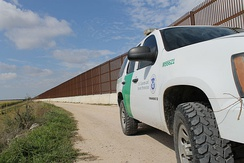 Border Patrol vehicle along a portion of the Mexico-United States border wall