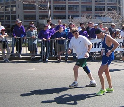 A runner getting encouragement at Mile 25 of the Boston Marathon