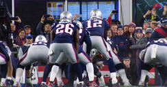 Brady receiving a snap, pictured from behind