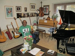 A multi-instrumentalist (father of Sharon and Karl Dyall) surrounded by his instruments.