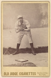 Doc Bushong on an 1888 Old Judge baseball card, showing glove.