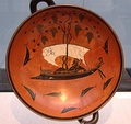 The Dionysus Cup, a 6th-century BC kylix with Dionysus sailing with the pirates he transformed to dolphins