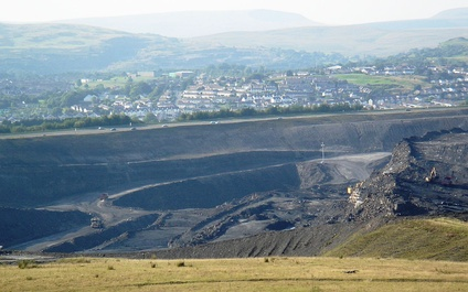 Part of Ffos Y Fran open cast mine, overlooking Dowlais, Penydarren and Gurnos, with the Breacon Beacons in the distance.