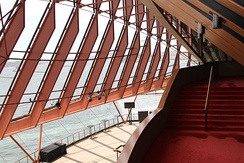 The foyer of the Joan Sutherland Theatre, showing the internal structure and steel framing of the glass curtain walls; the final constructions were modified from Utzon's original designs