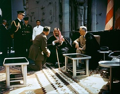 King Ibn Saud converses with President Franklin D. Roosevelt on board the USS Quincy, after the Yalta Conference in 1945