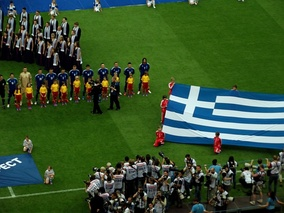 Greek players singing the Greek national anthem in Euro 2012 opening match against the hosts Poland (1–1).