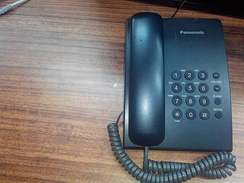 A fixed-line telephone on a desk