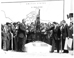 U.S. President Lyndon B. Johnson (left) and Mexican President Adolfo López Mateos (right) unveil the new boundary marker signaling the peaceful end of the Chamizal dispute.