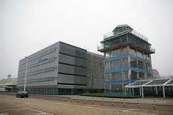 The Convair Building, which houses KLM Cityhopper and KLM offices, and the original Schiphol control tower
