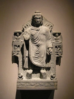 The Buddha demonstrating control over the fire and water elements. Gandhara, 3rd century CE