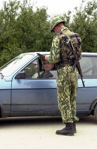 A Russian soldier at a checkpoint in Kosovo in 2001