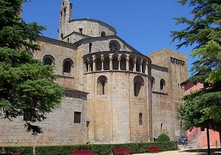 The Cathedral of Santa Maria d'Urgell, Catalonia, has an apsidal east end projecting at a lower level to the choir and decorated with an arcade below the roofline. This form is usual in Italy and Germany.