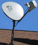 Satellite television dish on a residence