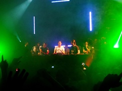 Swedish House Mafia and Italian DJ Benny Benassi performing in 2011.