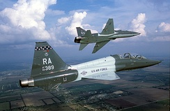 Air-to-air right side view of a USAF T-38 Talon aircraft from 560th Flying Training Squadron, Randolph AFB, Texas as his lead performs a left pitchout