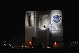 Xenon lights illuminate the 525 ft (160 m) tall Vehicle Assembly Building at Kennedy Space Center, Florida where workers make repairs on September 30, 2004.
