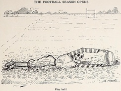 Cartoon showing a figure with a skeletal head holding a football upright with extended arms while lying down on a football field