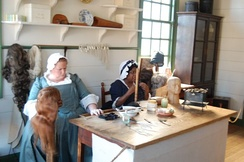 Historical reenactment of wig making in Colonial Williamsburg, Virginia
