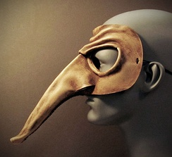 A leather version of a Zanni mask, profile view