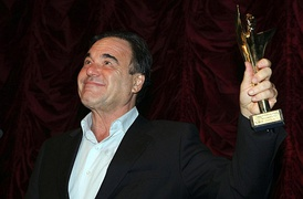 Oliver Stone with Golden Alexander in hand