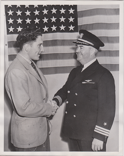 Hutchinson, age 22, is congratulated upon his 1941 enlistment in the U.S. Navy.