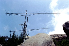 A set of two long Yagi antennas for the 2 meter band fed in phase to obtain more gain and narrow main lobe of radiation (station WA6PY)