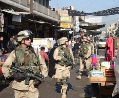 U.S. Paratroopers from the 82nd Airborne Division patrol the streets of the Al Sudeek district of Mosul, Iraq, in January 2005.