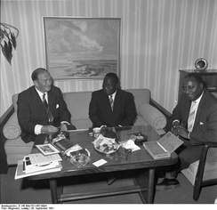 West German vice minister of workfare, Wilhelm Claussen (left), with Paul Armegee, transport minister of Togo, in Bonn, 1961