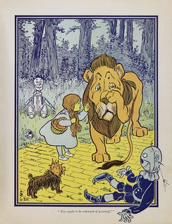 Some of the major characters from Baum's first book The Wonderful Wizard of Oz from left to right; Tin Woodman, Toto, Dorothy Gale, Cowardly Lion, and Scarecrow
