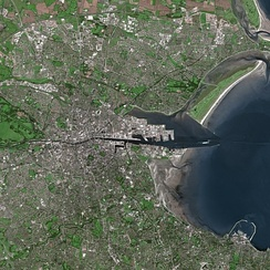 Satellite image showing the River Liffey entering the Irish Sea as it divides Dublin into the Northside and the Southside.