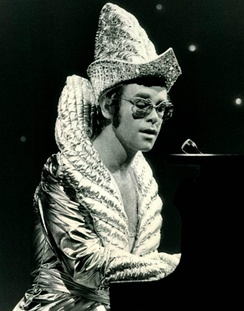 Performing in 1975, Elton often wore elaborate stage costumes