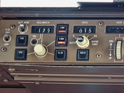Autopilot controls of a Boeing 747 with legend written in Futura.  Use of the font is widespread in the aerospace industry for flight instrument and control markings