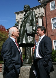 U.S. Senator Ben Cardin (left) and Maryland Attorney General Doug Gansler talk in Lawyer's Mall, near a statue of Thurgood Marshall. (October 2007)