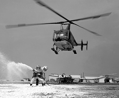 A USAF Huskie aids a practice firefighting operation at Cam Ranh Bay Air Base, Vietnam in 1968