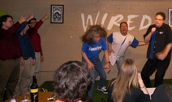 ComedySportz Austin performing a shortform game based on direction from the audience with the help of Red Dirt Improv; in this case spoofing a hard rock band performing a song made up on the stage