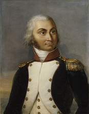 Color-tint print of a large-eyed man with his hair cut in the late 1700s style. He wears a dark blue military coat with a line of yellow braid.