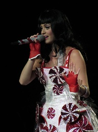 Perry performing in a dress decorated with peppermint swirls