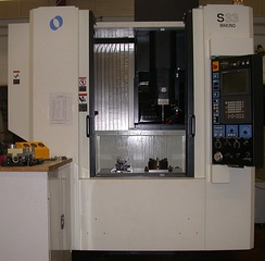 A CNC machining center, similar to those used by guitar manufacturers