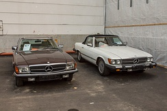 Two Mercedes-Benz SL: right with US-spec sealed beam type headlamps; left with normal headlamps for other markets