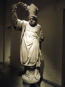 Statue of Saint Ambrose with a scourge in Museo del Duomo, Milan. Unknown Lombard author, early 17 century.