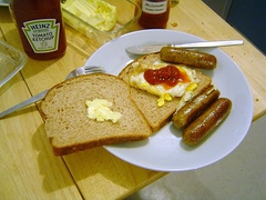 A sausage sandwich with egg and ketchup