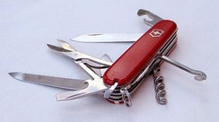 Folding pocket knife with multiple exposed tools
