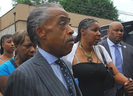 Sharpton and Eric Garner's widow, Esaw Garner (right), at a protest in Staten Island on July 19, 2014.