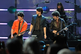 "Jonas Brothers performing in the Kids' Inaugural: ""We Are the Future"" concert in 2009"
