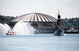 The Kingdome pictured behind USS Leahy (DLG-16) in 1982.