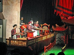 Chèo orchestra accompanies the performance of water puppetry